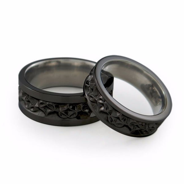 Black Titanium womens wedding ring or wedding band etched with hearts around the outside of the ring