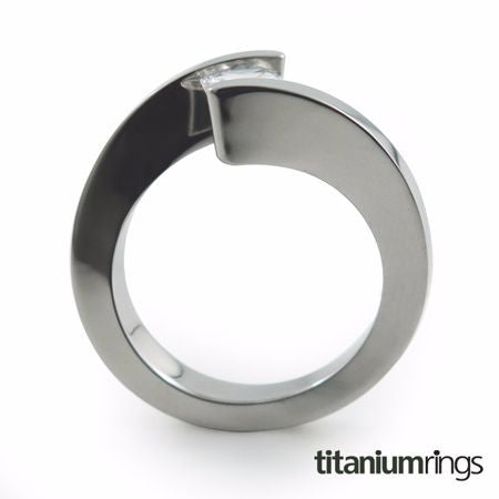 The Etoile Titanium engagement ring is clean and crisp in appearance. Your Gemstone sits flawlessly and appears to float