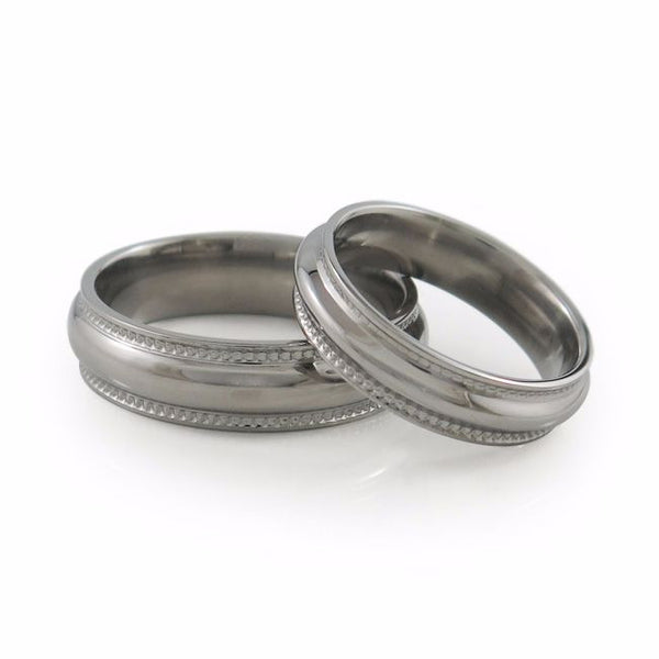 The Crescent Titanium wedding ring is a classic domed band that has received a beautiful double row of