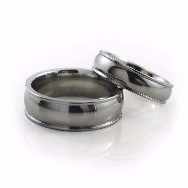The Chrysalis titanium ring features a wider centre domed profile, accented by two narrow, raised edges on each side