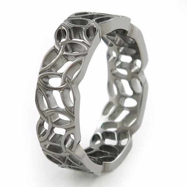 This one-of-a-kind ring incorporates a complex Triquetra knot pattern.