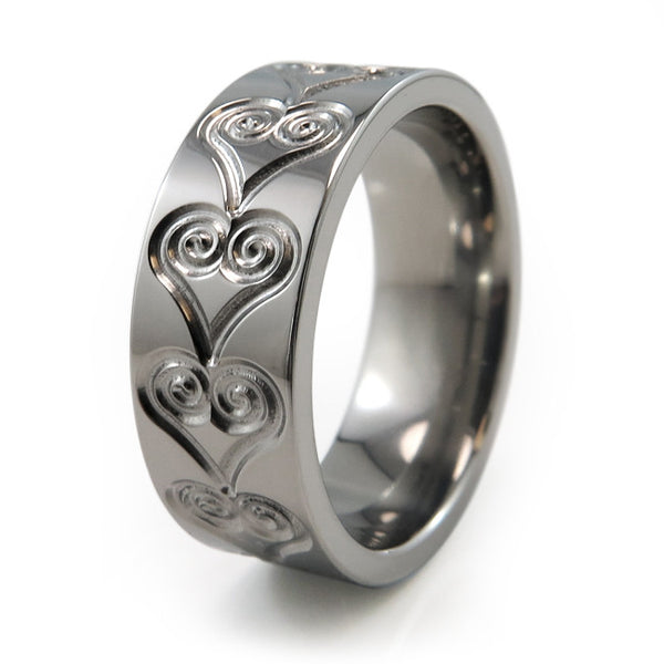 Titanium Ring adorned with heart etchings and engravings around the band.
