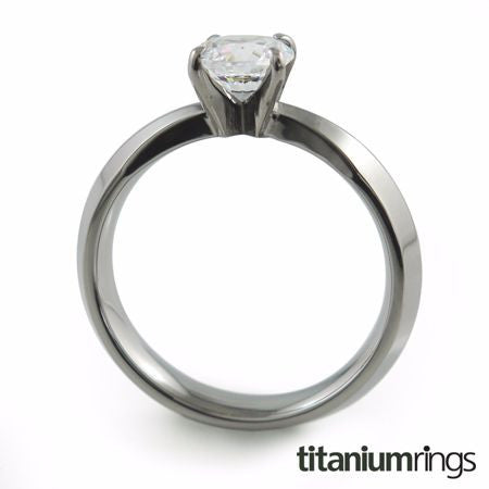 The Cleopatra titanium engagement ring features a dainty single prong setting and a slender band. 5mm stone.