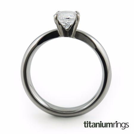 classic solitaire Titanium ring, featuring a dome profile band adorned with a beautiful gem.