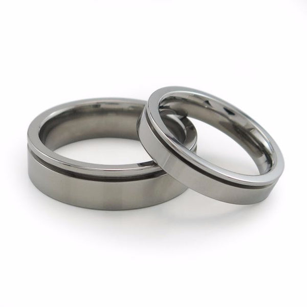 Mens titanium wedding band with inset grove. Mens titanium ring can be anodized with color. Comfort fit ring