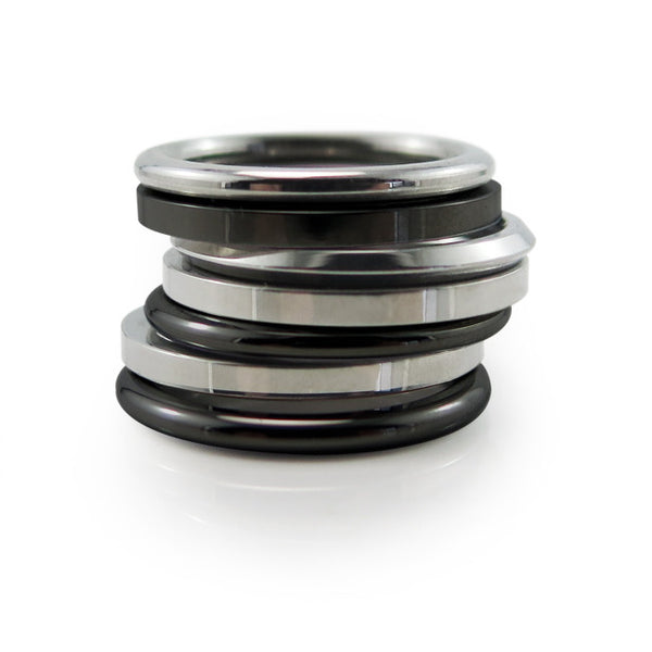 Stackable Titanium Rings in natural titanium or black.  Thin elegant rings you can mix and match for different looks.