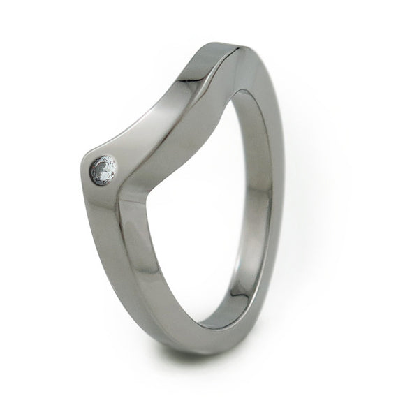 The Stella titanium companion band was created to complete the Stella wedding set.  We offer the option to have a small, 2mm round accent diamond, or colored gemstone in this ring design.