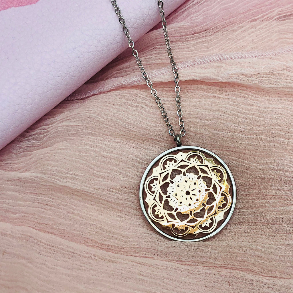 Stainless Steel Pendant with Rose Gold Filligree Detail