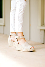 model wearing a suede wedge - epiphany boutiques