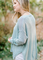 model in aqua sweater - epiphany boutiques
