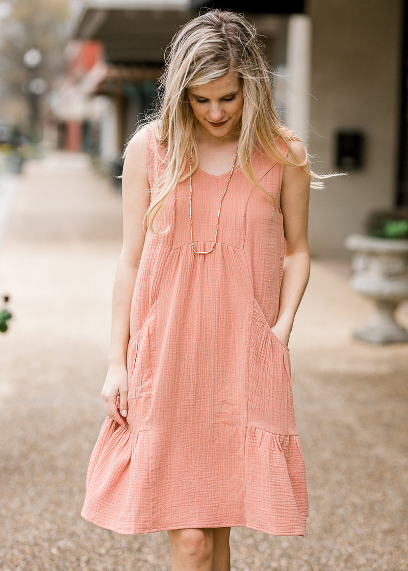 model in midi apricot dress - epiphany boutiques