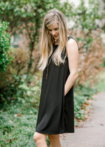 black sleeveless dress - epiphany boutiques