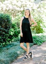 model in a black tie back dress -  epiphany boutiques