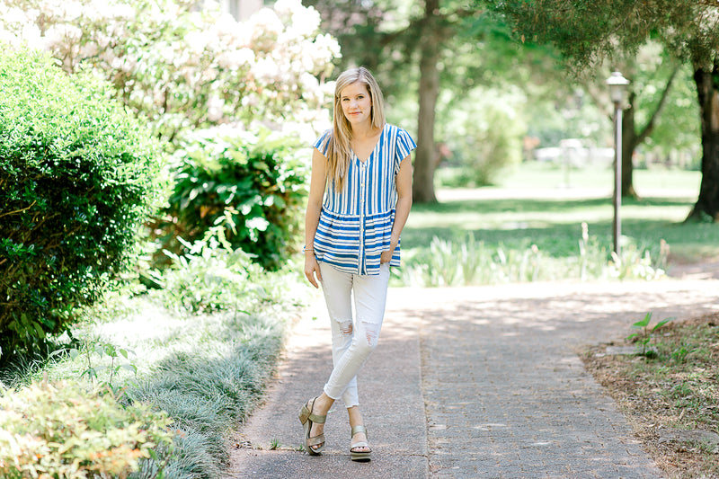 model wearing a blue and white top with cap sleeves - epiphany boutiques