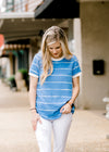 model wearing a blue top with small cream stripes - epiphany boutiques