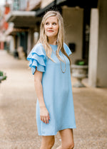 model in baby blue short sleeve dress - epiphany boutiques