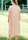 blush babydoll style dress back view - epiphany boutiques