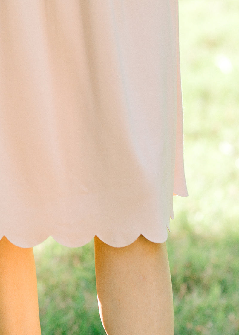 scalloped detail on blush dress - epiphany boutiques