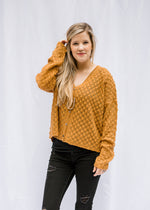 model in bronze sweater - epiphany boutiques