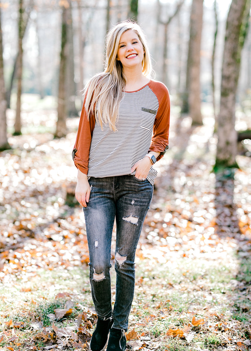 model in gray skinny jeans - epiphany boutiques