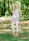 model in a silver sleeveless top with ruffles - epiphany boutiques