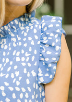 ruffle detail on sleeveless top at neckline and sleeve -  epiphany boutiques