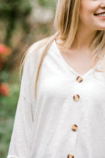 buttons on white shirt - epiphany boutiques