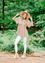 model in a blush pink and brown dot top - epiphany boutiques