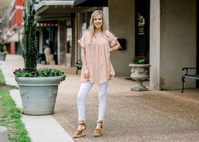 model in a pale coral top - epiphany boutiques