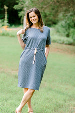 model in a dots and stripes blue dress - epiphany boutiques