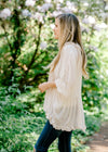 cream top with unfinished ruffles - epiphany boutiques
