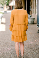 mustard dress on model - epiphany boutiques