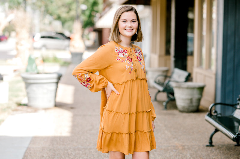 model in mustard dress - epiphany boutiques