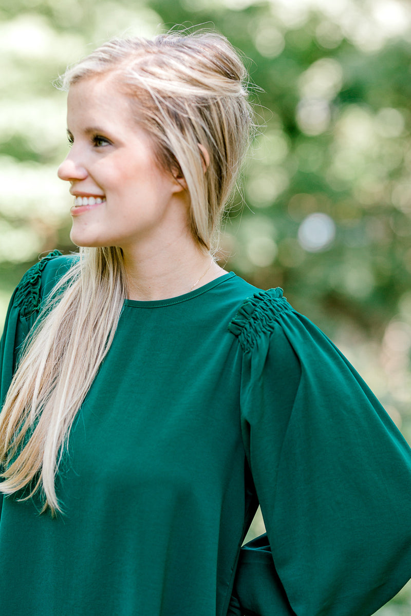 model wearing a emerald dress -  epiphany boutiques