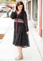 model in a black and white dress with embroidery - epiphany boutiques