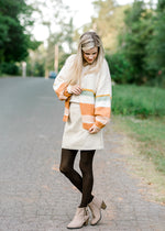 model wearing a stripe cardigan - epiphany boutiques