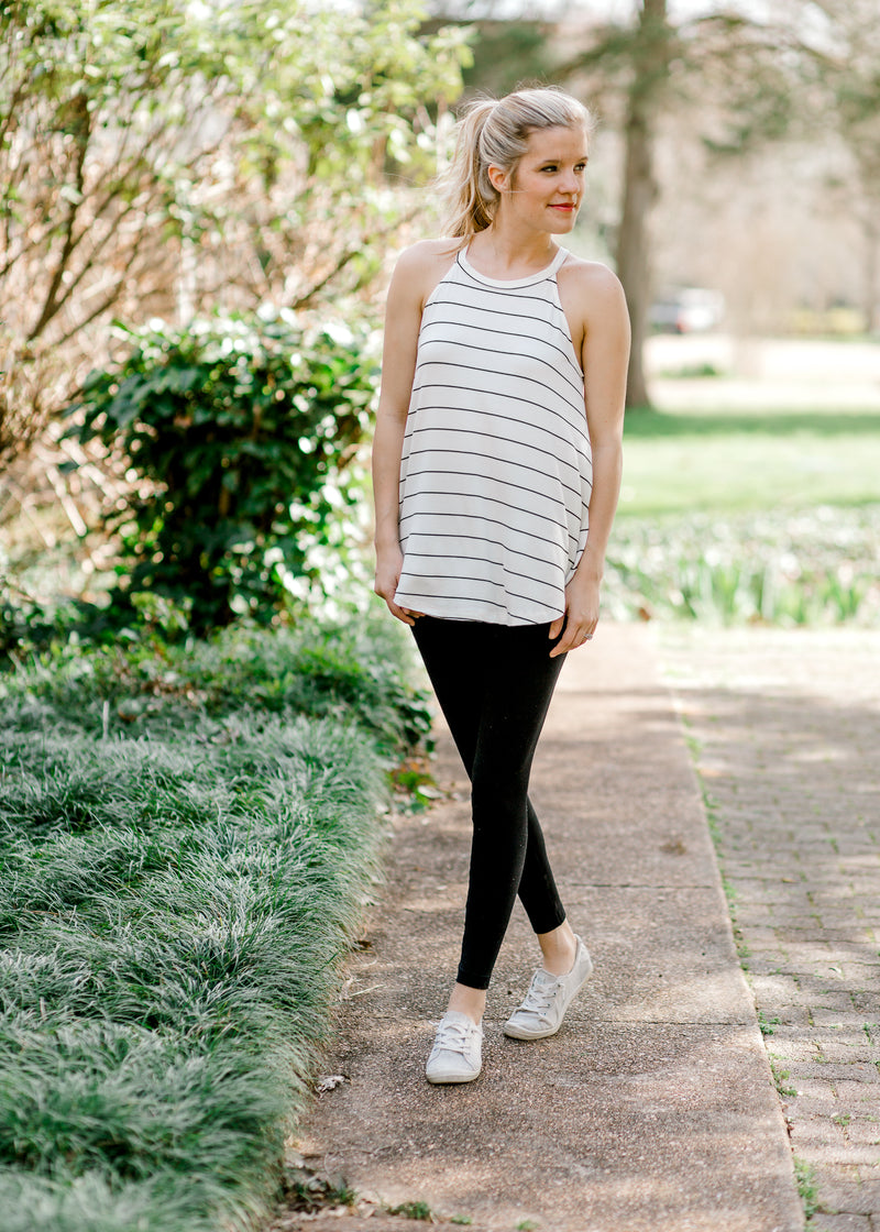 model wearing black and white tank top - epiphany boutiques