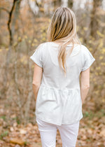 back view of blueish heathered grey top - epiphany boutiques