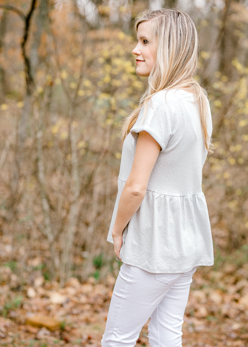 model wearing a short sleeve peplum top - epiphany boutiques