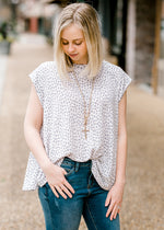 detail of cream and grey dots - epiphany boutiques