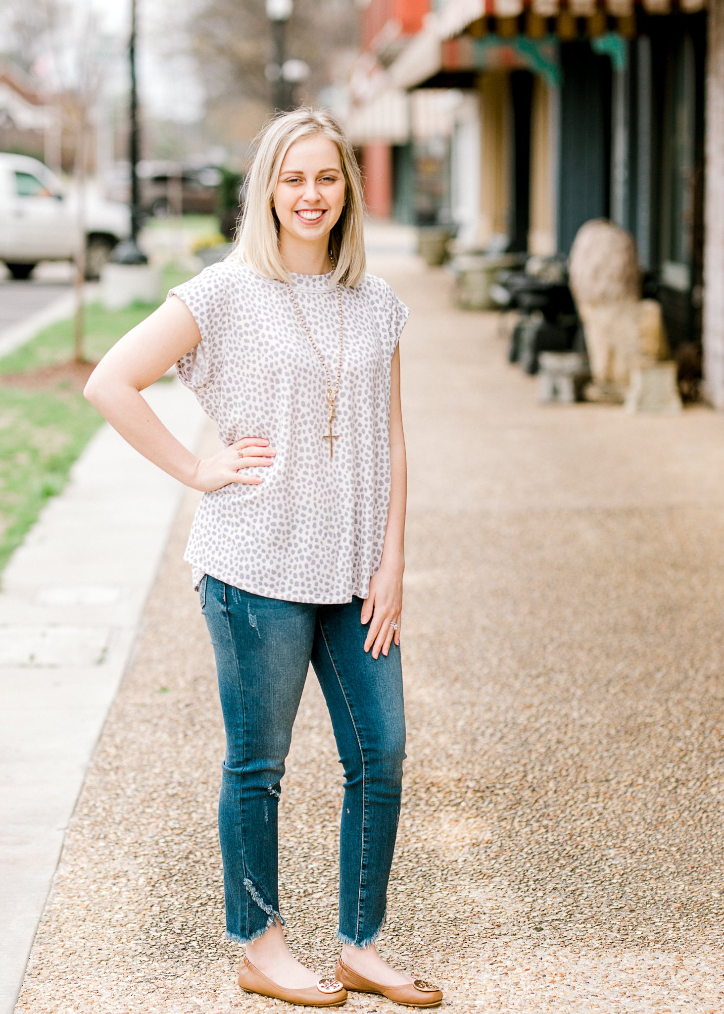 model wearing grey and white dot top - epiphany boutiques
