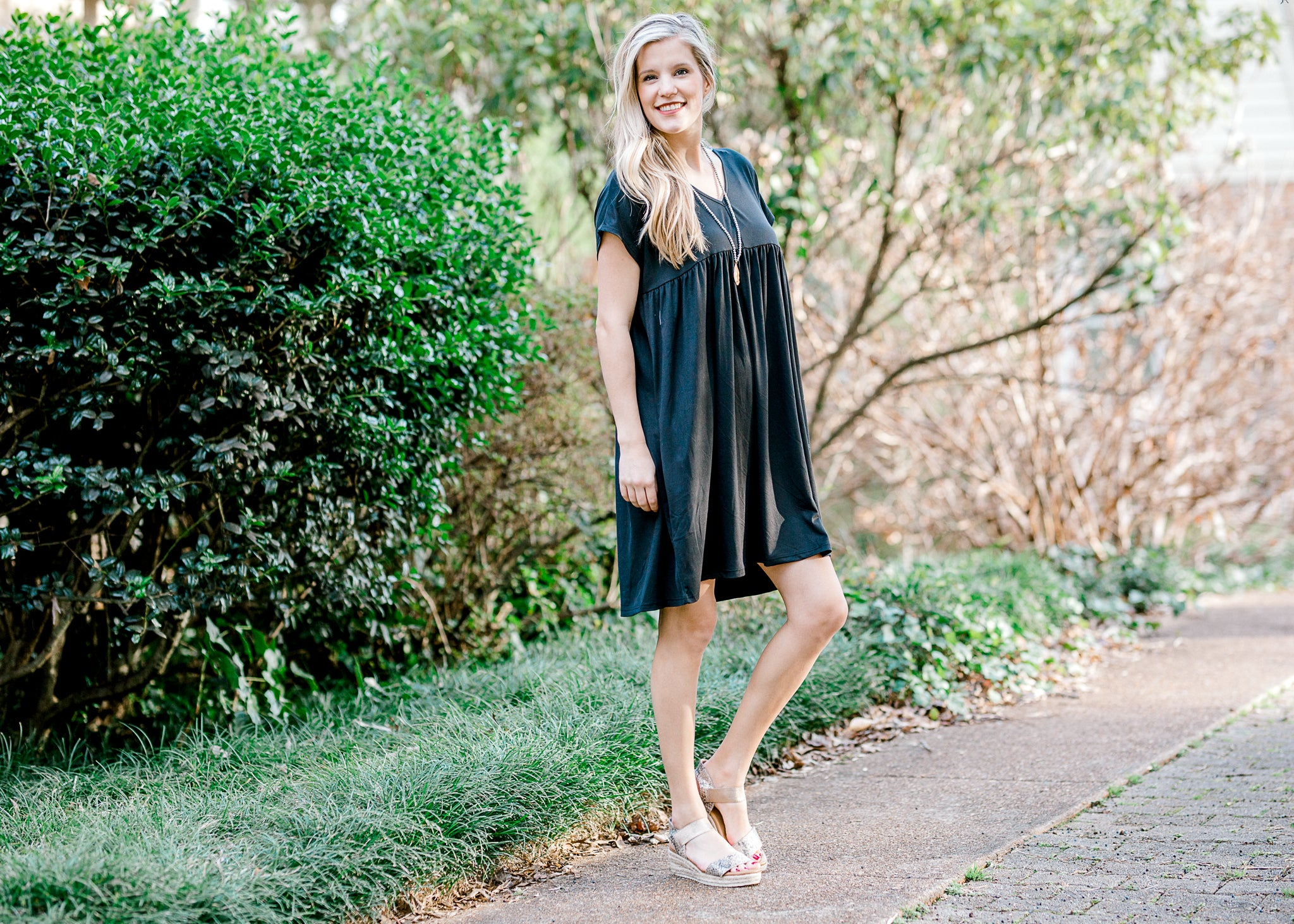 model in a black babydoll dress - epiphany boutiques