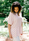 model wearing a pink and red top with stripes - epiphany boutiques
