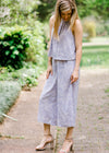 Lavender with cream flowers Jumpsuit for women front view, racer back, mid calf length. Epiphany Boutiques