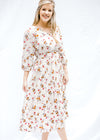 ivory background dress with flowers - epiphany boutiques