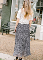 model wearing a black and white midi skirt - epiphany boutiques