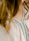 crochet detail on taupe top- epiphany boutiques