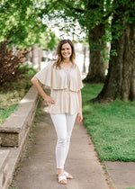 model in taupe top with blue crochet detailing - epiphany boutiques