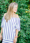 white background dress with blue and black stripes - epiphany boutiques