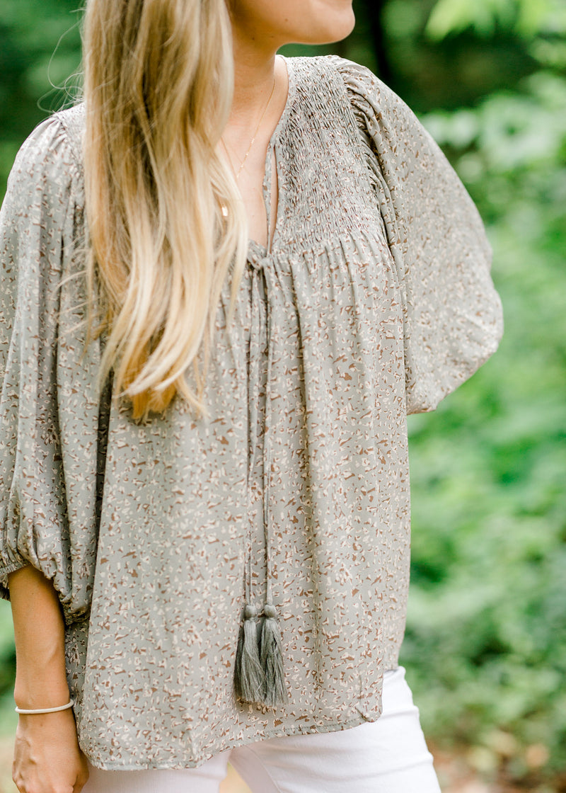 tassel on a smocked sage top - epiphany boutiques